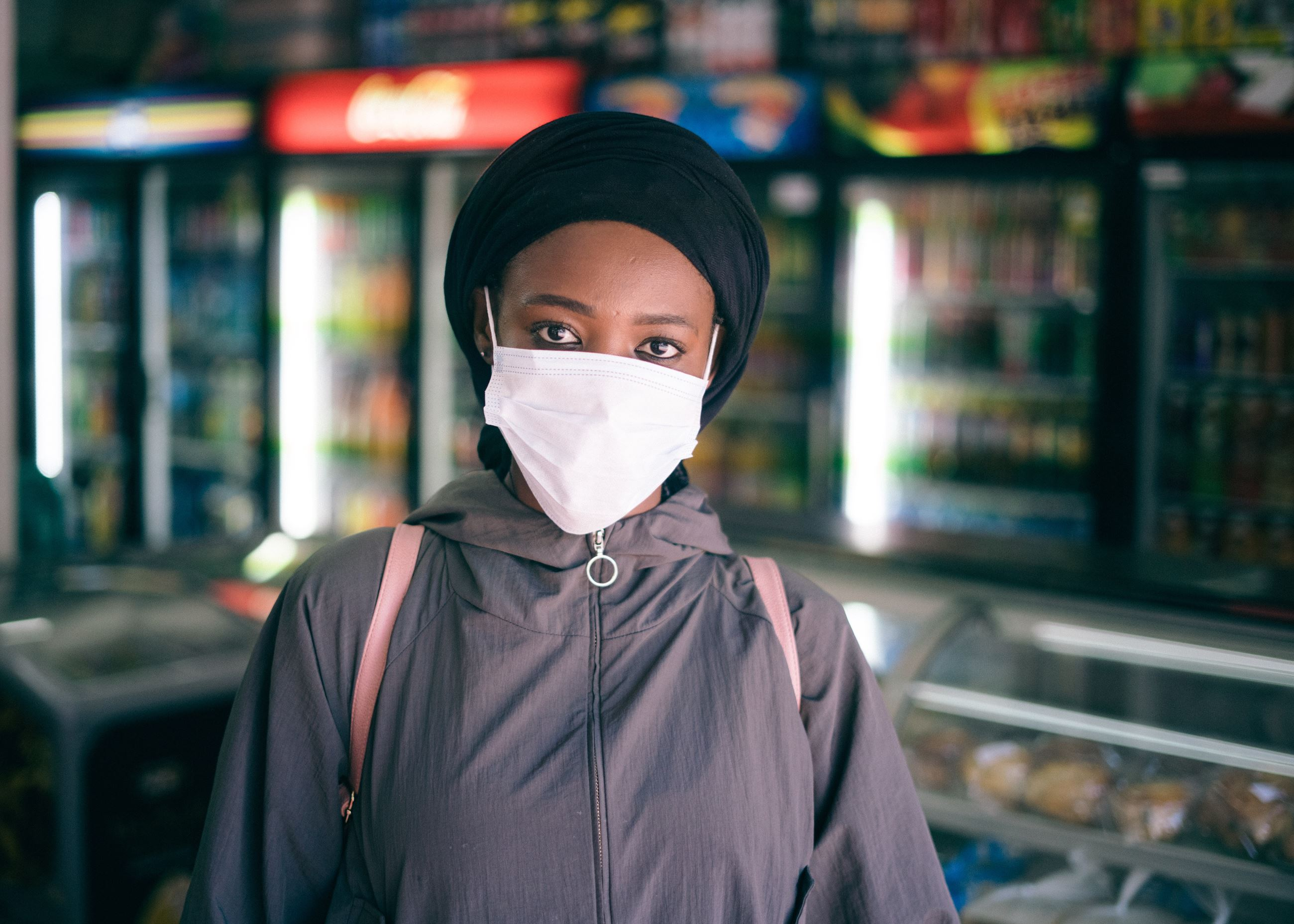 A woman wears a protective mask in store